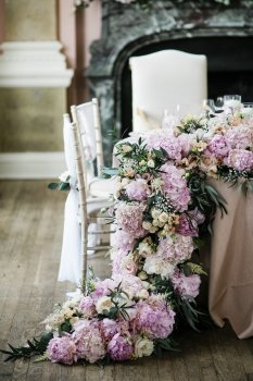 Fresh flower garland cascading over edge of table