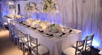 Table centrepiece of white flowers and candles